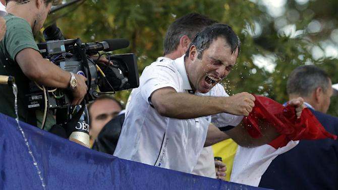 Europe's Francesco Molinari celebrates after winning the Ryder Cup PGA golf tournament Sunday, Sept. 30, 2012, at the Medinah Country Club in Medinah, Ill. (AP Photo/Charlie Riedel)