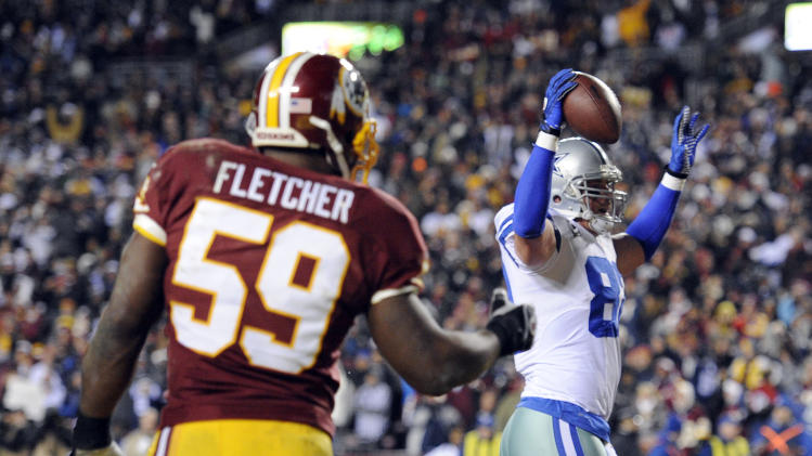 Dallas Cowboys tight end Jason Witten (82) celebrates his touchdown in front of Washington Redskins linebacker London Fletcher (59) during the first half of an NFL football game Sunday, Dec. 30, 2012, in Landover, Md. (AP Photo/Nick Wass)