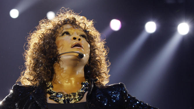 """FILE - In this Sunday, April 25, 2010, file photo, U.S singer Whitney Houston performs at the o2 in London as part of her European tour, Sunday, April 25, 2010. Whitney Houston was the """"top trending"""" search of 2012 according to Google Inc.'s year-end """"zeitgeist"""" report. Google's 12th annual roundup is """"an in-depth look at the spirit of the times as seen through the billions of searches on Google over the past year,"""" the company said in a blog post Wednesday. (AP Photo/Joel Ryan, File)"""