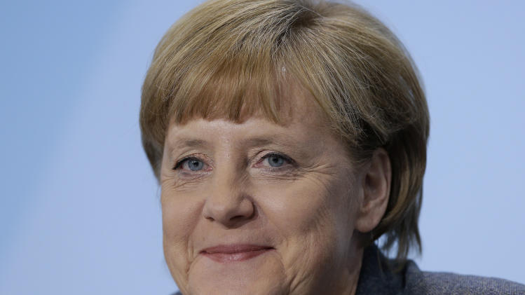 German Chancellor Angela Merkel smiles during a press conference after an energy summit at the chancellery in Berlin, Germany, Friday, Nov. 2, 2012. German Chancellor Angela Merkel met with the country's 16 state governors and various ministers to coordinate the country's energy transition from nuclear to renewable power sources within a decade.  (AP Photo/Michael Sohn)