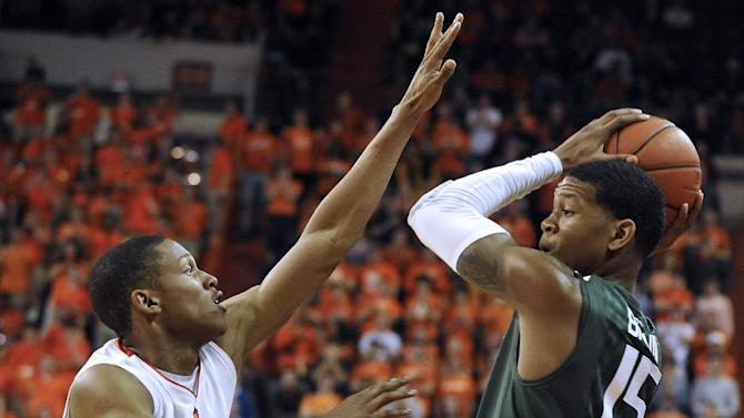 Miami's Rion Brown (15) looks to pass as Clemson's Jordan Roper (20) defends in the first half of an NCAA college basketball game, Sunday, Feb. 17, 2013, in Clemson, S.C. (AP Photo/Rainier Ehrhardt)