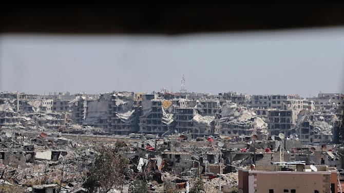 Moscow, a key ally of Syria, said mortar fire aimed at its embassy complex in Damascus appeared to have come from the Jobar neighborhood of the Syrian capital, pictured from a Syrian army post in March