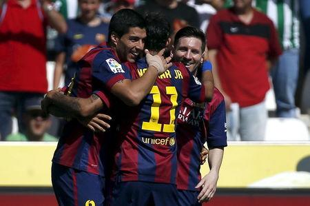 Barcelona's Luis Suarez celebrates a goal with team mates Lionel Messi and Neymar during their Spanish first division soccer match against Cordoba at El Arcangel stadium in Cordoba