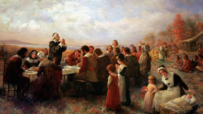 """FILE - This Tuesday, Nov. 15, 2005 photo shows a detail of the 1914 Jennie Brownscombe painting """"The First Thanksgiving at Plymouth"""" hanging at the Pilgrim Hall Museum in Plymouth, Mass. The painting is labeled at the museum as being historically inaccurate, noting that the clothes are incorrect, and there were no log cabins in Plymouth in the early 17th century. New England is a region defined by its compact geography, its culture and its """"sense of place,"""" as Harvard history professor Laurel Thatcher Ulrich put it. """"The mystique that has grown up over the centuries, perpetuated by the invention of celebrations like the 'First Thanksgiving' and all the images associated with the Revolution,"""" she said, """"convinced people that there really was something called New England and that it mattered."""" (AP Photo/Pilgrim Hall Museum, File)"""