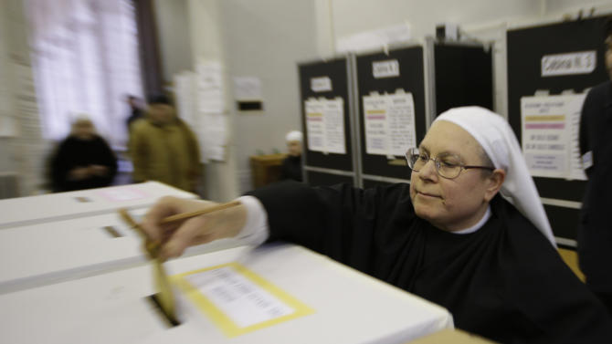 A nuns casts her ballot in a polling station in downtown Rome, Sunday, Feb. 24, 2013. Italy votes in a watershed parliamentary election Sunday and Monday that could shape the future of one of Europe's biggest economies. (AP Photo/Andrew Medichini)