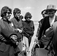 Bob Dylan arrives in France, surrounded by his band, in 1966. Dylan, who releases his 35th album this week half a century after his first, is still going strong