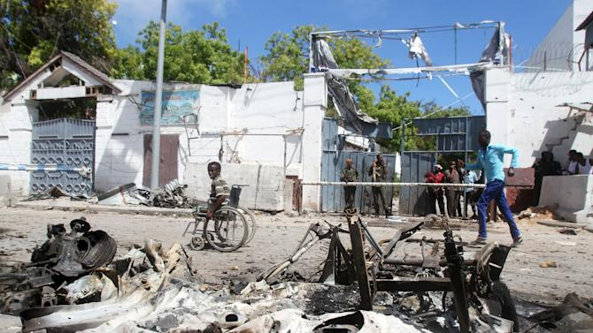 The wreckage of a car used by suicide bombers in an attack targeting a restaurant in Somalia's capital Mogadishu