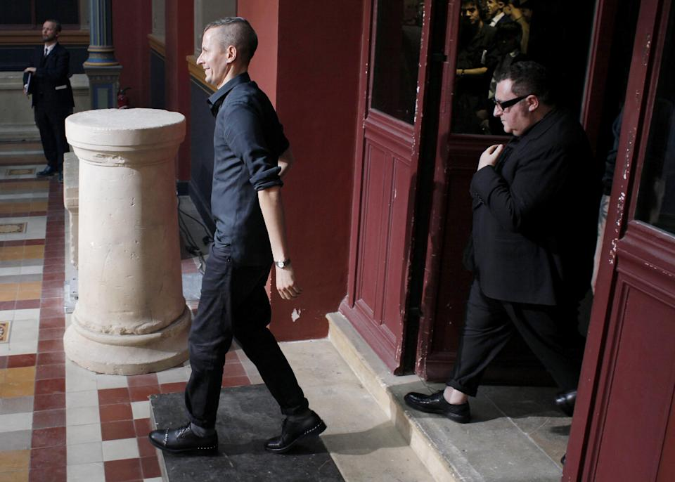 Dutch fashion designer Lucas Ossendrijver, left, and creative director Alber Elbaz, of Israel, arrive after the presentation of Lanvin's Spring-Summer 2014 men's collection, Sunday, June 30, 2013 in Paris. (AP Photo/Thibault Camus)