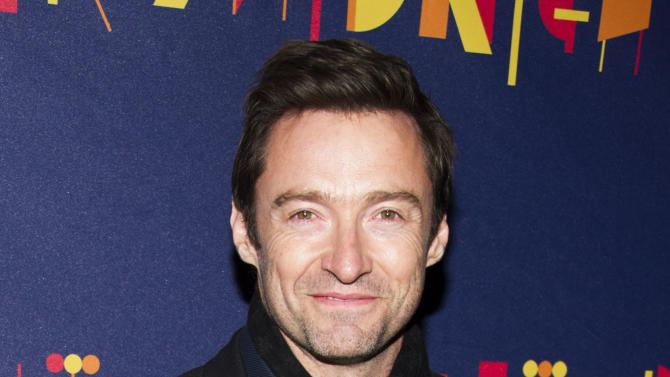 "FILE - This Nov. 3, 2013 file photo shows actor Hugh Jackman at the Broadway opening of ""After Midnight"" in New York. Jackman says he jacked to host the Tony Awards for the third time, but fans of his stage work won't have to wait long to see the Tony-winning star onstage again. Jackman says he's doing the play ""The River"" later this year and ""looking forward to treading the boards here on Broadway."" (Photo by Charles Sykes/Invision/AP, File)"
