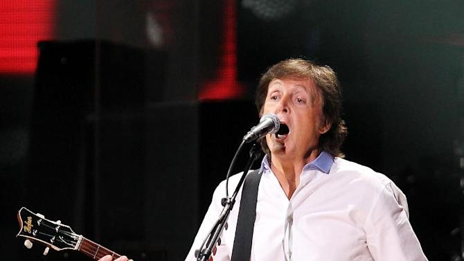 This image released by Starpix shows Paul McCartney at the 12-12-12 The Concert for Sandy Relief at Madison Square Garden in New York on Wednesday, Dec. 12, 2012. Proceeds from the show will be distributed through the Robin Hood Foundation. (AP Photo/Starpix, Dave Allocca)