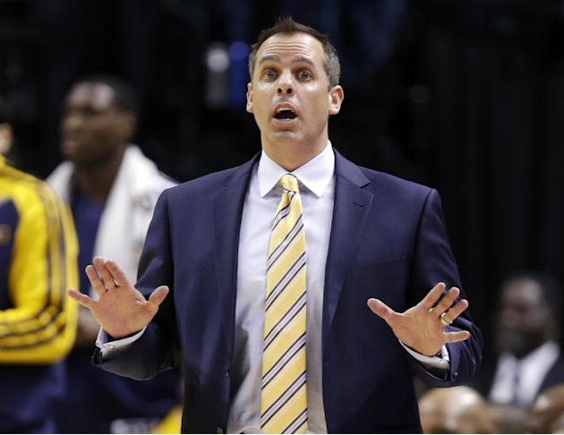 Indiana Pacers head coach Frank Vogel yells to his team in the second half of an NBA basketball game against the Miami Heat in Indianapolis, Tuesday, Dec. 10, 2013. The Pacers won 90-84