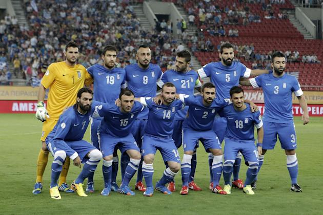 In this Sept. 10, 2013 file photo, Greece national soccer team poses prior to the start of a World Cup Group G qualifying soccer match between Greece and Latvia at the Karaiskaki stadium in Piraeus po