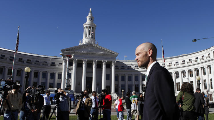 Brian Vicente co-director of the Yes on 64 campaign waits to start a news conference about the legalization of marijuana at Civic Center Park in Denver on Wednesday, Nov. 7, 2012.  Colorado voters passed Amendment 64 on Tuesday legalizing marijuana in Colorado for recreational use. (AP Photo/Ed Andrieski)