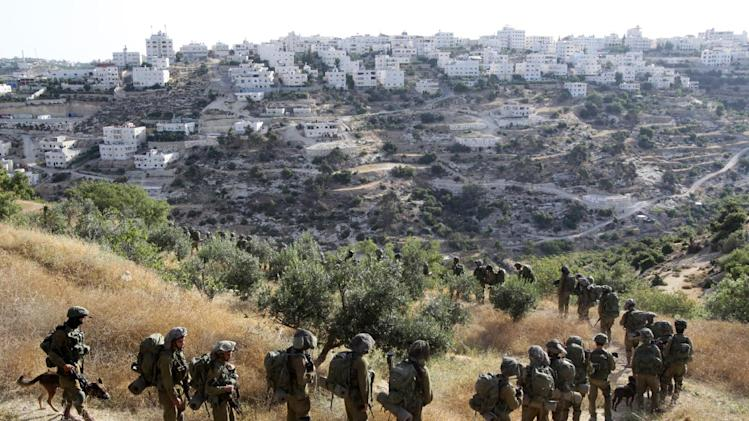 Israeli soldiers search for the missing teenagers during an operation in the West Bank town of Hebron, on June 17, 2014