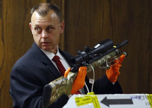 "Investigator Michael Adcock testifies at trial about one of the rifles recovered from the crime scene where ""American Sniper"" Chris Kyle was killed. (REUTERS/Mike Stone)"
