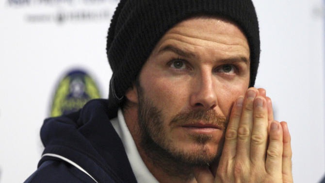 Los Angeles Galaxy midfielder David Beckham gestures during a press conference  after a friendly soccer match between LA Galaxy and an Indonesian national team  as part of their Asia Pacific Tour 2011at Gelora Bung Karno Main Stadium in Jakarta, Indonesia, Wednesday, Nov 30, 2011.(AP Photo/Achmad Ibrahim)