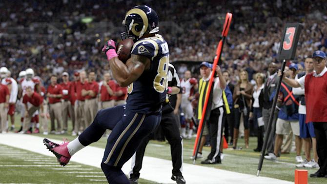 St. Louis Rams tight end Lance Kendricks catches a 7-yard pass for a touchdown during the first quarter of an NFL football game against the Arizona Cardinals, Thursday, Oct. 4, 2012, in St. Louis. (AP Photo/Tom Gannam)