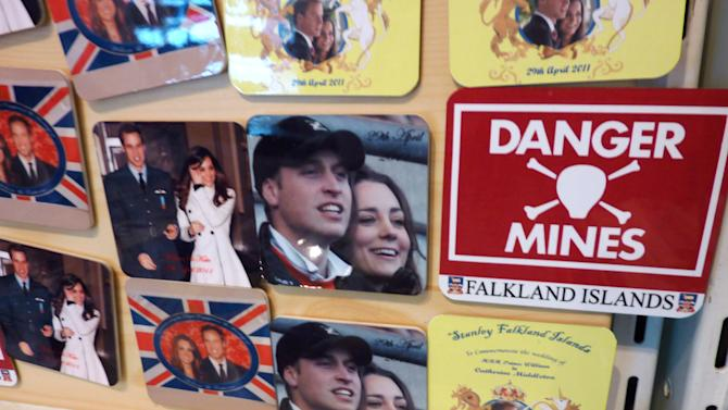 In this Sunday March 4, 2012 photo, magnets commemorating the Royal wedding of Britain's Prince William and Kate Middleton are displayed for sale at the Pod gift shop in Stanley, Falkland Islands. The magnets are about as close as most people here have come to spotting the future king of England, who has only strolled through town once so far during his six-week tour of duty in the Falklands.  (AP Photo/Michael Warren)