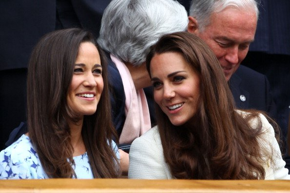 Pippa Middleton (L) and Catherine, Duchess of Cambridge sit in the Royal Box during the Gentlemen's Singles final match between Roger Federer of Switzerland and Andy Murray of Great Britain on day thi