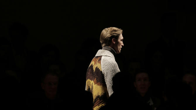 Milan designers fall back on the classics