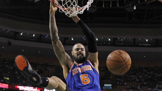 New York Knicks center Tyson Chandler (6) dunks against the Boston Celtics during the first half in Game 4 of a first-round NBA basketball playoff series in Boston, Sunday, April 28, 2013. (AP Photo/Elise Amendola)