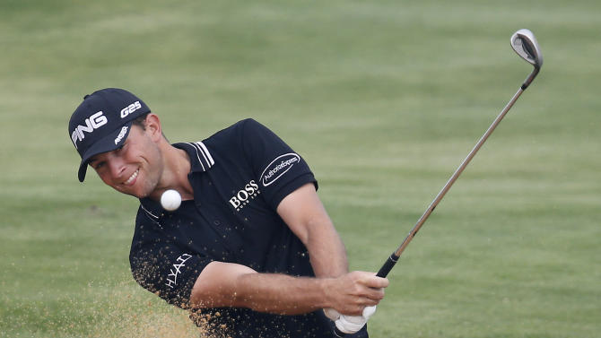 Early leader Luke Guthrie of the U.S. hits out of a bunker on 7th green during the first round of the BMW Masters golf tournament at the Lake Malaren Golf Club in Shanghai, China, Thursday, Oct. 24, 2013. (AP Photo/Eugene Hoshiko)