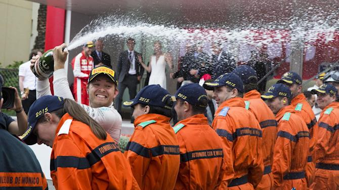 Mercedes driver Nico Rosberg of Germany sprays champagne after winning the Formula One Grand Prix of Monaco at the Monaco racetrack, in Monaco, Sunday, May 24, 2015. (AP Photo/Gero Breloer)