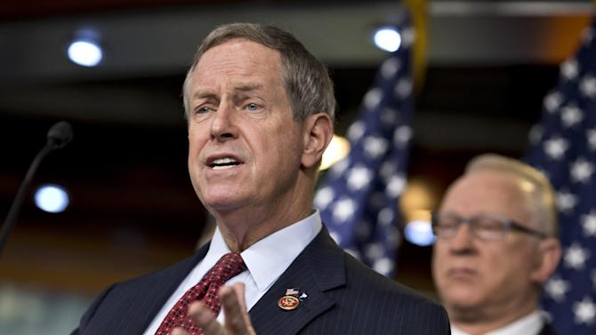 House Military Personnel subcommittee Chairman Rep. Joe Wilson, R-S.C., left, accompanied by House Armed Services Chairman Rep. Buck McKeon, R-Calif., gestures during a news conference on Capitol Hill in Washington, Friday, March 1, 2013, to talk about the effect of the automatic budget cuts on the military. (AP Photo/J. Scott Applewhite)