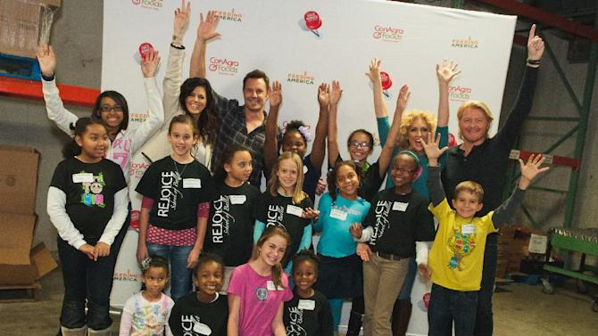 IMAGE DISTRIBUTED FOR CONAGRA FOODS - This year's Country Music Association Award winners, Little Big Town, pose with Nashville area children while volunteering during the Second Harvest Food Bank of Middle Tennessee Backpack program, benefiting children on Tuesday, Nov.13, 2012 in Nashville, TN. The effort is part of Little Big Town's support of ConAgra Foods' Child Hunger Ends Here campaign, which helps raise awareness of the nearly 17 million children in the U.S. impacted by hunger. (Dean Dixon/AP Images for ConAgra Foods)