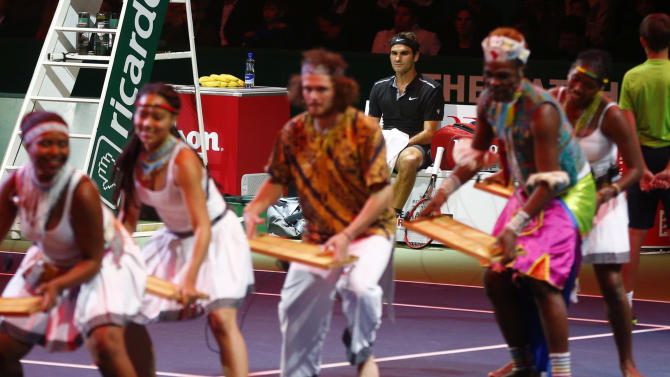 "Switzerland's Federer watches artists performing before ""The match for Africa 2"" charity tennis match in Zurich"