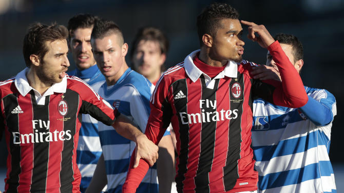 AC Milan Ghana midfielder Kevin-Prince Boateng, right, is flanked by his teammate Mathieu Flamini as he gestures towards the crowd in Busto Arsizio, near Milan, Italy, Thursday, Jan. 3, 2012. A friendly match between AC Milan and lower division club Pro Patria was abandoned Thursday after racist chants directed at Milan's black players, the latest incident of racial abuse that continues to blight the sport. After repeated chants directed his way, Ghana midfielder Kevin-Prince Boateng picked up the ball and kicked it at a section of the crowd in the 26th minute of the first half. Boateng then took off his shirt and walked off the pitch with his Milan teammates. Urby Emanuelson, Sulley Muntari and M'Baye Niang were also targeted by the chants. (AP Photo/Emilio Andreoli)