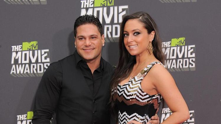"Ronnie Ortiz-Magro, left, and Samantha ""Sammi Sweetheart"" Giancola arrive at the MTV Movie Awards in Sony Pictures Studio Lot in Culver City, Calif., on Sunday April 14, 2013. (Photo by Jordan Strauss/Invision/AP)"