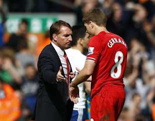 Liverpool's Steven Gerrard (R) is greeted by manager Brendan Rodgers as he leaves the pitch following their English Premier League soccer match agains...