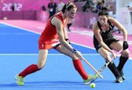 Britain's Kate Walsh (L) is challenged by New Zealand's Cathryn Finlayson during the women's field hockey bronze medal match at The Riverbank Arena in London. Great Britain, inspired by skipper Walsh who broke her jaw just a week ago, beat New Zealand 3-1 to earn an Olympic bronze medal, something they last achieved 20 years ago in Barcelona