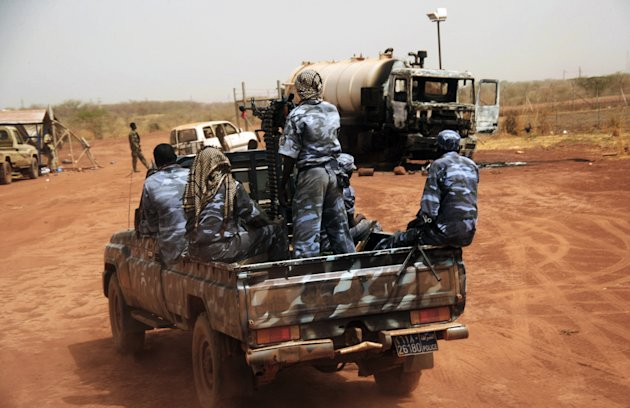 In this Tuesday, April 24, 2012 photo, Sudanese armed forces ride a military vehicle at the oil-rich border town of Heglig, Sudan. The African Union says Sudan must stop the aerial bombardment of South Sudan and has called on both countries to cease hostilities immediately. (AP Photo/Abd Raouf)