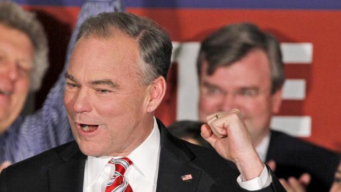 FILE - In this Nov. 6, 2012 file photo, Sen.-elect Timothy Kaine, D-Va. celebrates his win, in Richmond, Va. (AP Photo/Steve Helber, File)