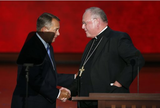 Cardinal Dolan shakes hands with U.S Speaker of the House Boehner after delivering the closing benediction during the final session of the Republican National Convention in Tampa