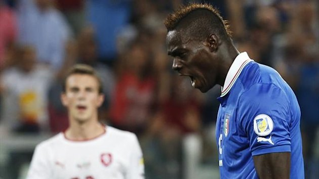 Italy's Mario Balotelli celebrates after scoring a penalty against Czech Republic during their 2014 World Cup qualifying match at the Juventus stadium (Reuters)