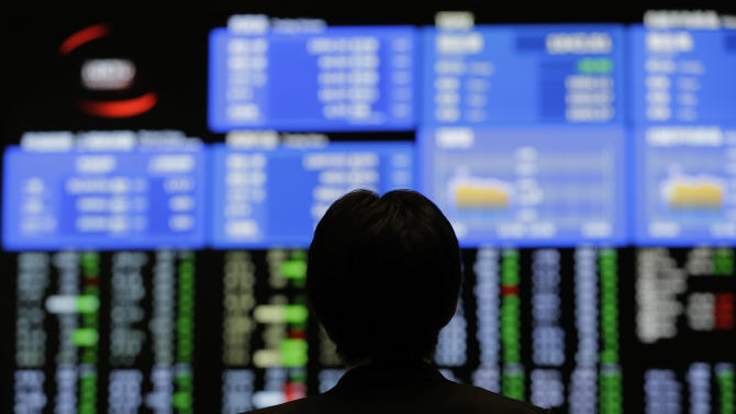 A man looks at an electronic stock board at the Tokyo Stock Exchange in Tokyo, Friday, June 7, 2013. Asian stock markets fell Friday, ignoring a rebound on Wall Street, as investors stayed on the sidelines ahead of a key U.S. jobs report later in the day. (AP Photo/Itsuo Inouye)