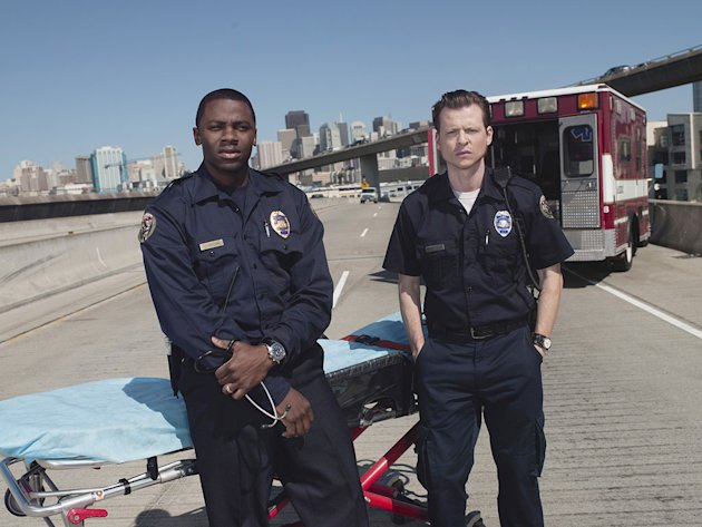Kevin Rankin as Tyler and Derek Luke as Boone in the NBC series Trauma. 