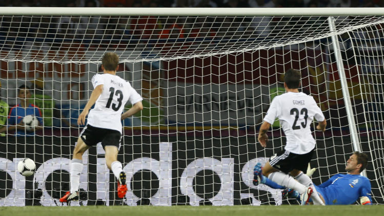 Germany's Mario Gomez, second right,  scores  a goal during the Euro 2012 soccer championship Group B match between the Netherlands and Germany in Kharkiv, Ukraine, Wednesday, June 13, 2012. (AP Photo/Frank Augstein)