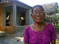 Gyani Maiya Sen, 76, poses for a photo at her home in the remote district of Dang in western Nepal. The 76-year-old, part of a vanishing tribe in remote western Nepal, is the only surviving speaker of Kusunda, a language of unknown origins and unique sentence structures that has long baffled experts