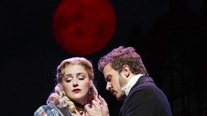 """This theater image released by Boneau-Bryan/Brown shows Betsy Wolfe, left, and Will Chase in a scene from """"The Mystery of Edwin Drood,"""" playing at the Roundabout Theatre Company at Studio 54 in New York. (AP Photo/Boneau-Bryan/Brown, Joan Marcus)"""