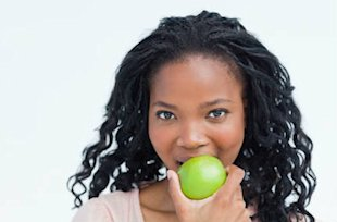 Woman eating green apple healthy eating