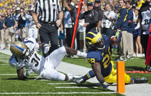 No. 11 Michigan beats Akron 28-24, avoids upset