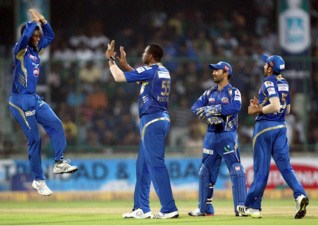 MI players celebrates fall of wicket during the 2nd CLT20 semi-final match between Mumbai Indians and Trinidad & Tobago at Feroz Shah Kotla, Delhi on Oct. 5, 2013. (Photo: IANS)