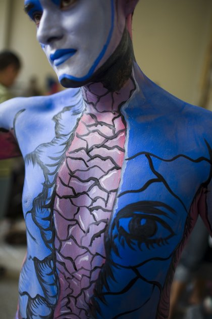 A man covered in body paint …