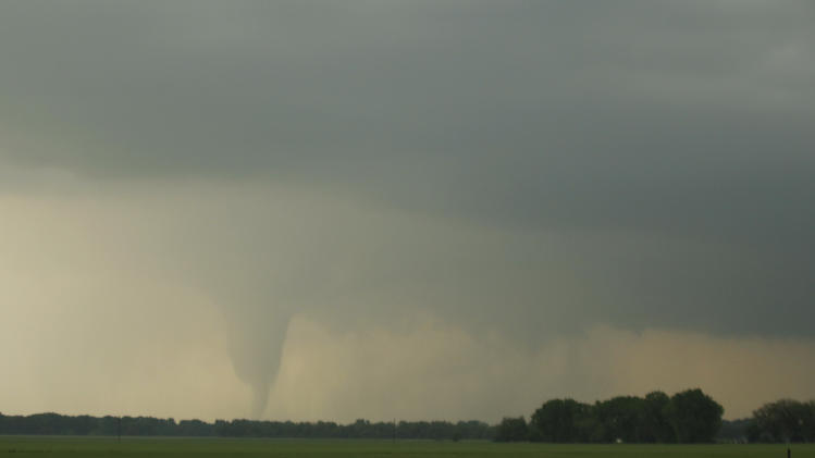 A tornado forms and touches down north of Soloman, Kan., Saturday, April 14, 2012. (AP Photo/Orlin Wagner)