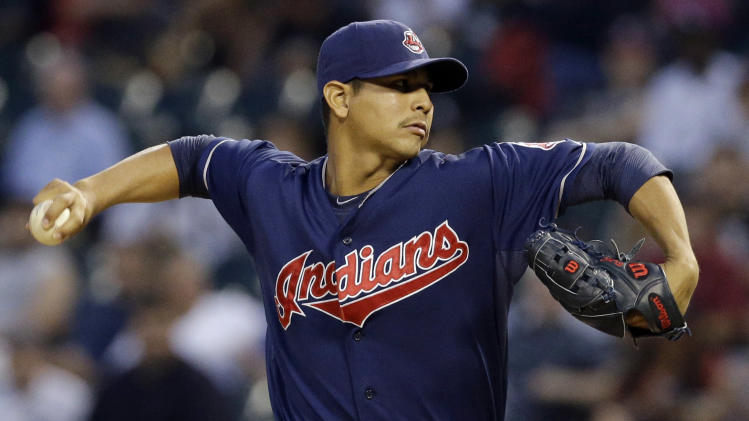 Cleveland Indians starter Carlos Carrasco throws against the Chicago White Sox during the first inning of a baseball game in Chicago, Thursday, Aug. 28, 2014. (AP Photo/Nam Y. Huh)