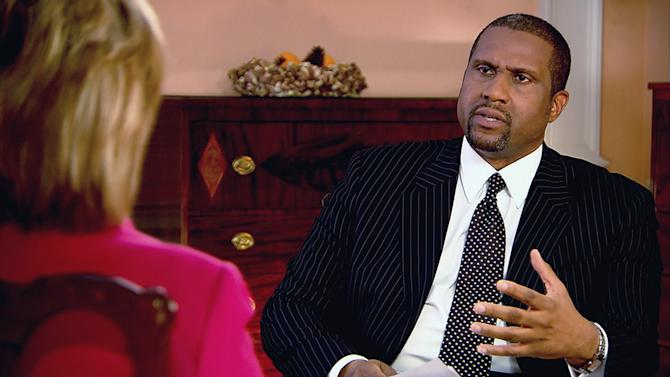 """This undated image from video released by PBS shows host Tavis Smiley, right, during an interview with Hillary Rodham Clinton on """"Tavis Smiley Reports."""" Smiley, who's marking his 10th year this month as host of his PBS talk show and his 20th year in broadcasting. (AP Photo/PBS)"""